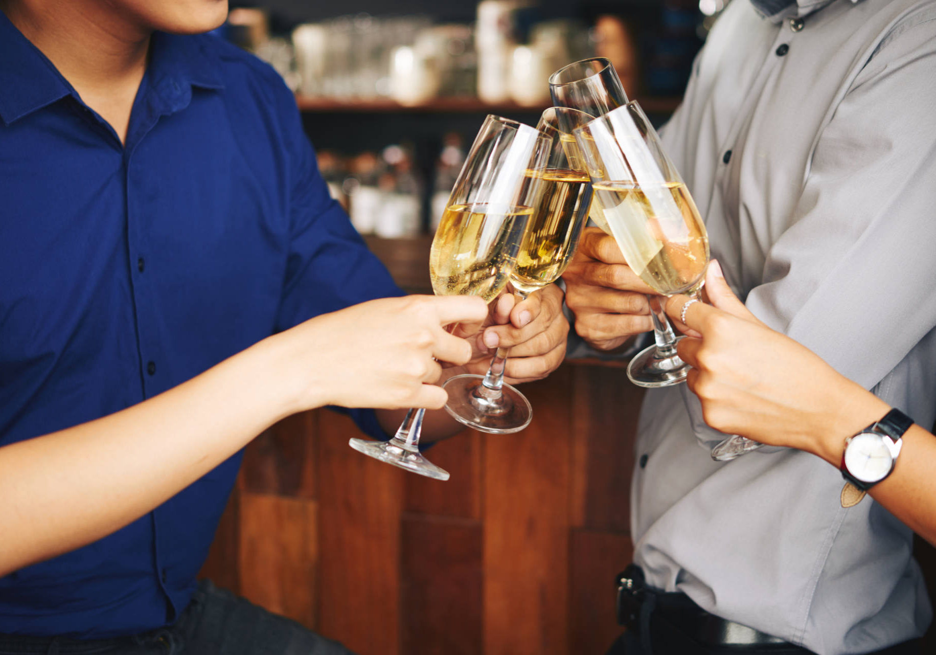 Close-up image of people drinking champagne to celebrate something